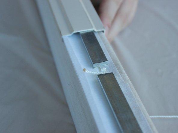 Slide the bottom rail back onto the shade.