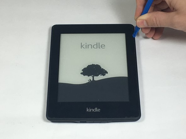 Insert plastic opening tool into the corners of the Paperwhite and slide around the edge perimeter to remove bezel.