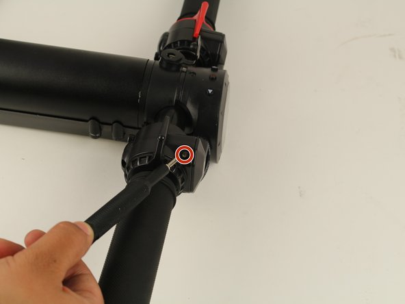 Remove one 4 mm Phillips #1 screw located directly above the acceleration lever.