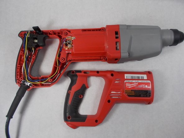 Remove the red Housing Assembly by lifting it up off of the tool.