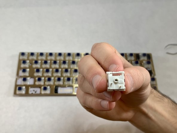 Never push in any direction other than straight down. It is easy to damage both the PCB keyboard and the switch in this step. You should not wiggle or bend the switch.