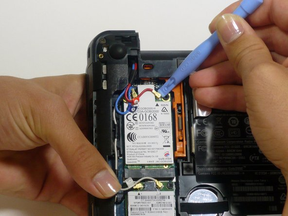 Disconnect the two gold antenna cables from the WWAN card using a plastic opening tool.