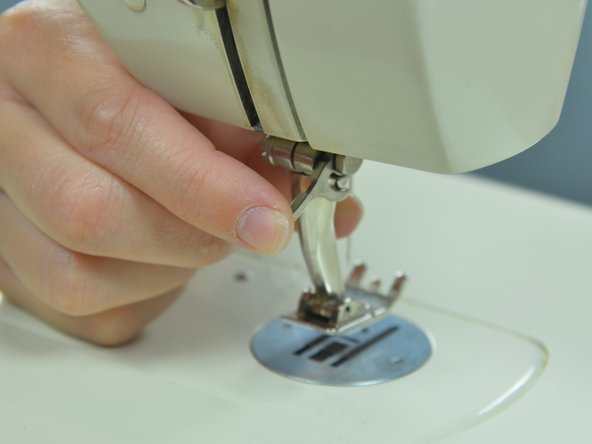Slide the presser foot lever down to lock the new foot in place.
