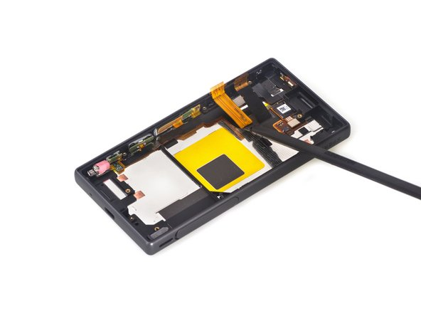 Loosen all adhesive underneath side button flex assembly.