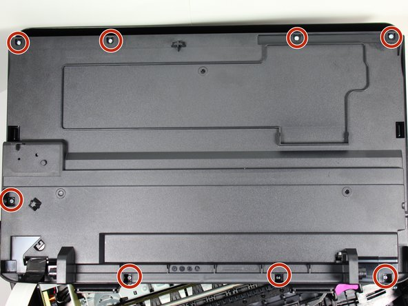 Remove the eight 2.0 mm x 14 mm hex screws on the back of the cartridge access door by using the hex screwdriver and rotating counterclockwise.