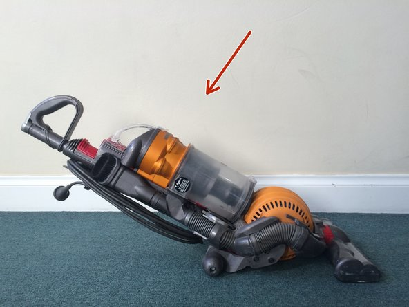 Recline vacuum all the way to expose as much of the ball as possible.