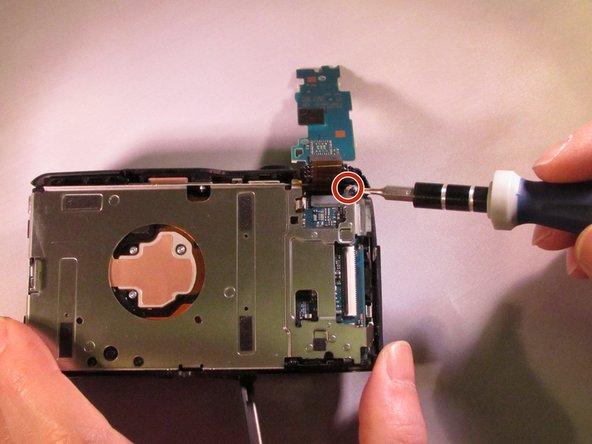 Remove the black M1.4 X 3.5 Phillips head screw in upper right corner of device.