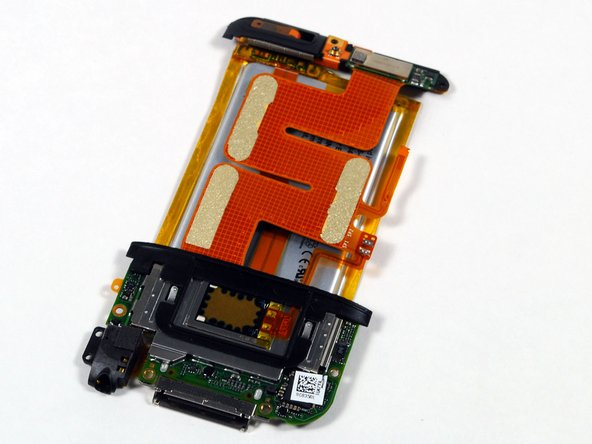 The large orange cable connects the WiFi antenna (upper left) to the logic board.