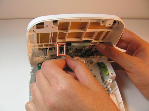 Gently pull out the ribbon cable from the circuit board.
