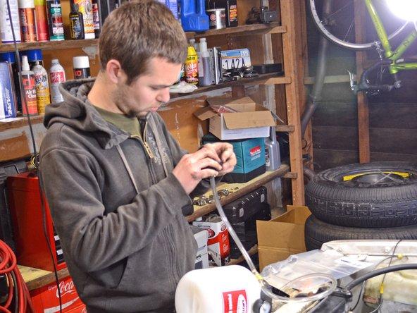 Place the Power Bleeder hose through the Power Bleeder cap and place the cap on the brake fluid reservoir.