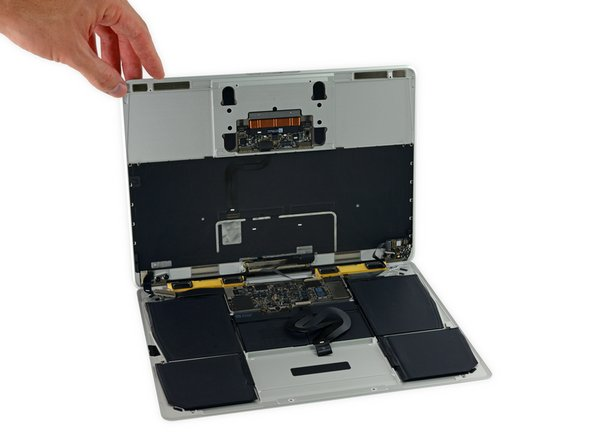 Carefully turn the MacBook over, so that the lower case lays flat.