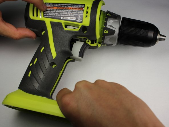 Gently lift the casing from the drill body.