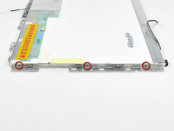 Remove the three 3.1 mm Phillips screws along the left edge of the display.
