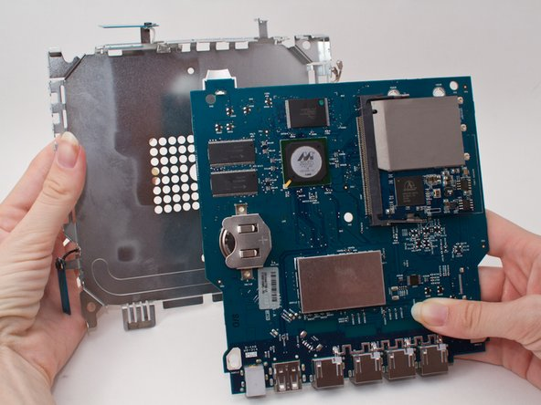 Remove the metal casing by gently prying the logic board away with you hands.
