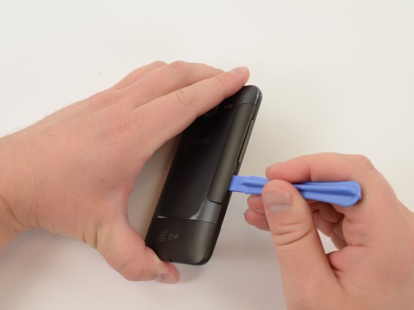 Remove battery cover using a plastic opening tool or finger nail.
