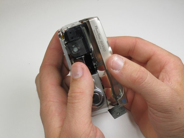Next, remove the front of the camera body. Be sure to keep track of the rubber ring.