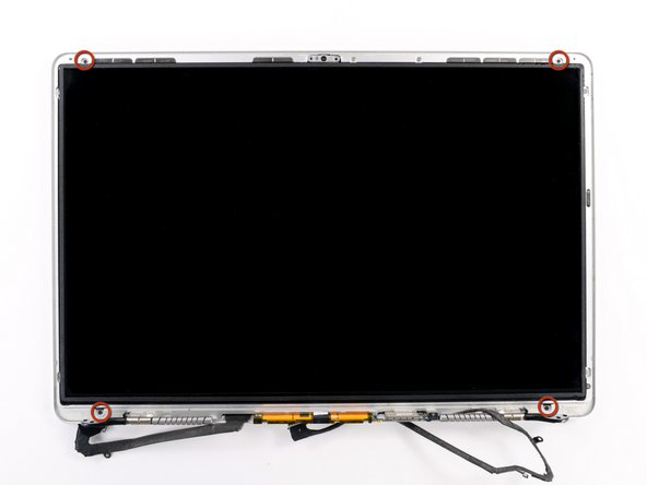 Remove the four 2.3 mm Phillips #00 screws securing the LCD to the rear display bezel.