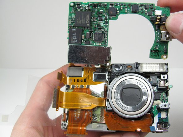 Free the logic board from the rest of the camera.
