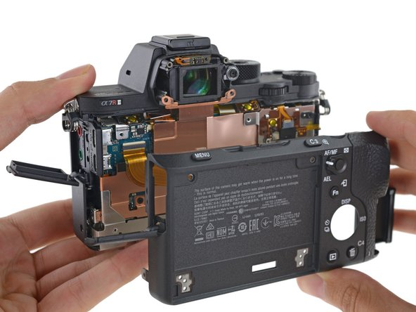 Now that the viewfinder frame and LCD panel have been removed, the rear housing pops right off.