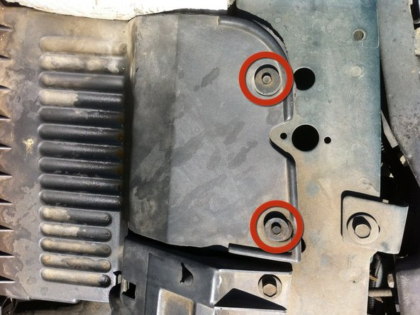 """Remove the two 3/16"""" screws that hold the air filter in place with a 3/16"""" nut driver."""