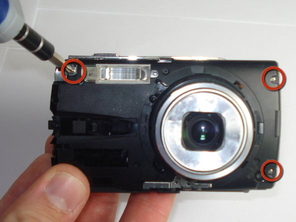 Remove the three Phillips #00 screws from the front of the camera.