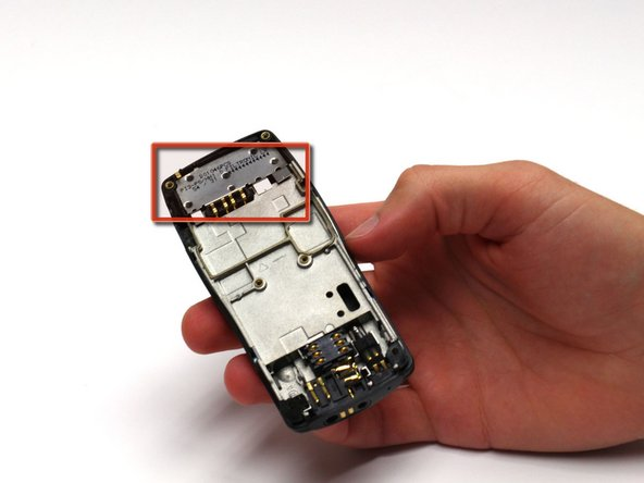 After removing the circuit board/faceplate sub-assembly, locate the antenna.