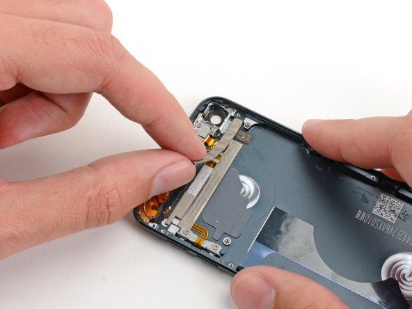 Peel and remove the foam tape from the rear case of the iPod.