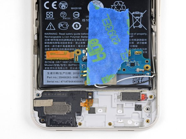 Flip the daughterboard over onto the battery and secure it out of the way with some tape.