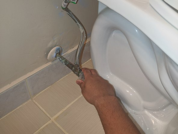 Turn off the water line using the valve.