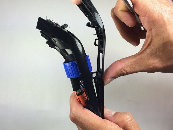 Pull the trimmer apart using your hands once the panel is at least halfway apart.