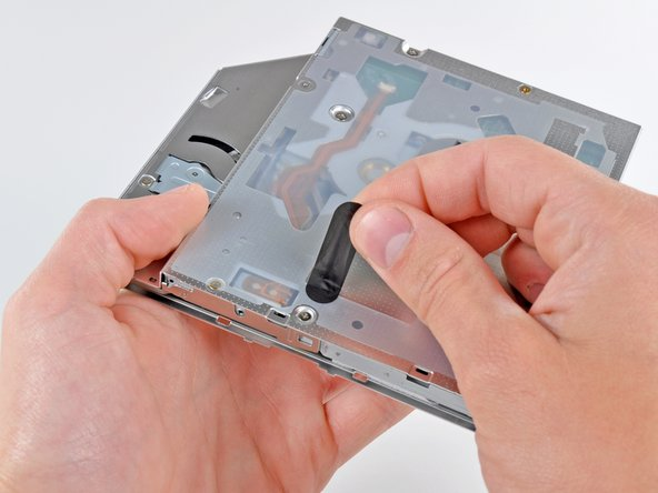 Peel off the strip of black tape covering the optical drive thermal sensor.