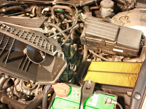 Lift the engine air filter housing cap and place it aside.