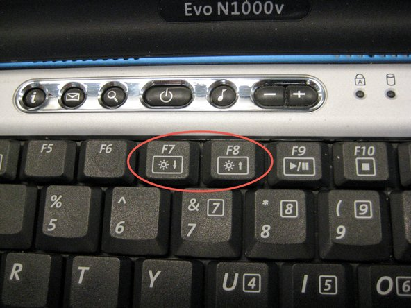 Insert a spudger between the F7 and F8 keys. Lift up to remove the LED cover.