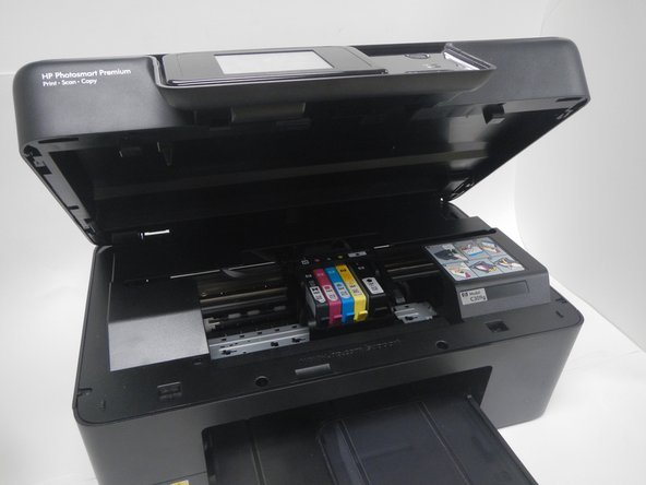 Open the top of the printer as shown.