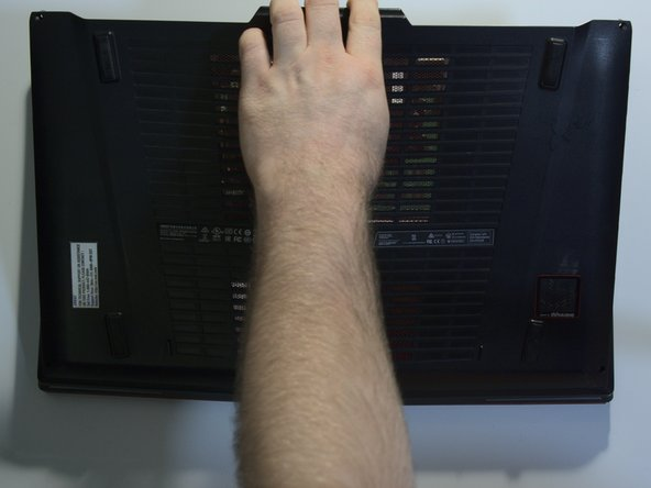 Gently pull from the rear of the case upwards to remove the bottom of the laptop.