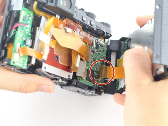 Do not pull hard when removing the backing because it could rip the orange strip attached to the motherboard.