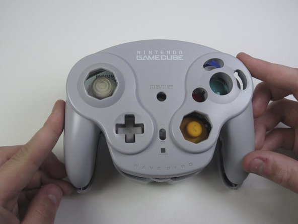 Carefully turn over the controller and place it on a flat surface.