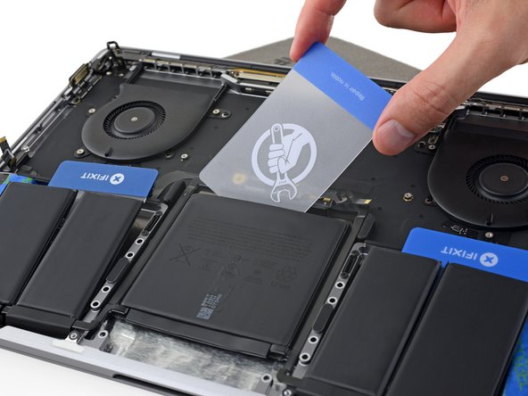 The final battery cell can be more difficult to remove. If needed, apply more adhesive remover to make the job easier.