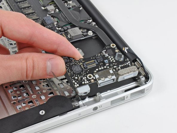 The MagSafe, USB port, and sound card are all part of one smaller board that connects to the logic board.