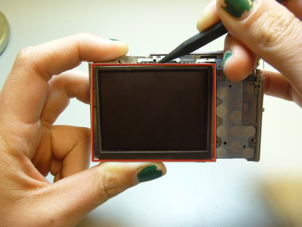 Use the spudger to pry the LCD from the camera.