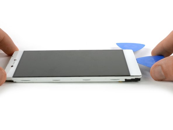 Loosen the adhesive under the bottom part of the display unit with the opening pick.