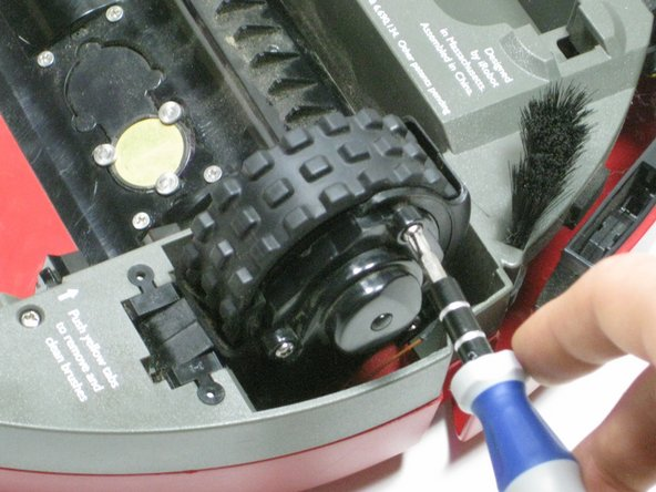 Next, locate the three screws on the iRobots hubcap/wheels. (You only need to unscrew one side)