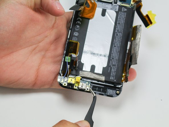 Use a pair of tweezers to remove the headphone jack/micro USB board.