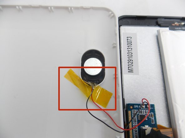 Remove the tape holding the speaker in its socket.