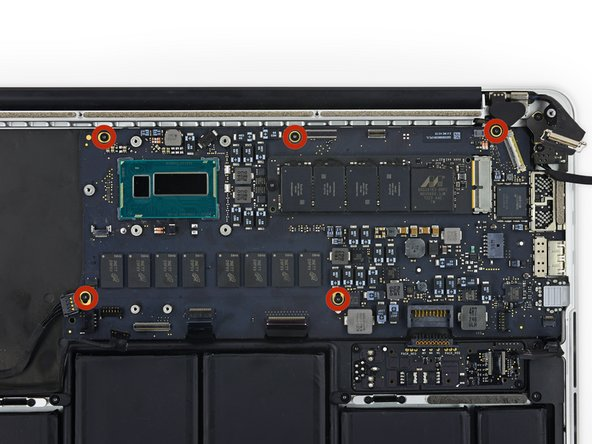 Remove the five 3.5 mm T5 Torx screws securing the logic board to the upper case.