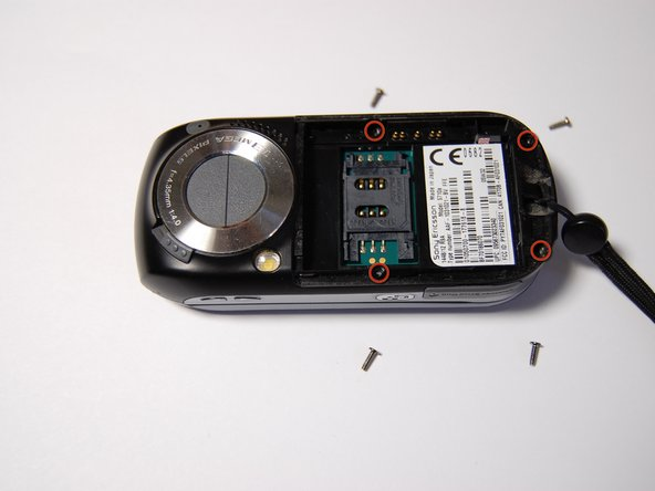 Remove the four 6mm phillips head screws located beneath the battery.