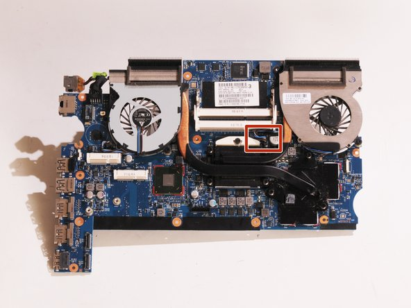 Unplug the second fan assembly cable by carefully pulling it upwards.