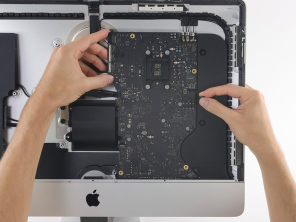 When removing and installing the logic board, take care not to damage the delicate microphone ribbon cable at the bottom left of the board.