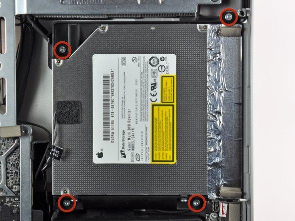 Retirez les quatre vis Torx T10 par lesquelles le lecteur optique est fixé au boîtier extérieur.