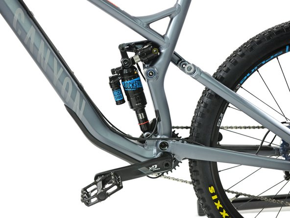 Provided that you used a bike stand, put the bike carefully back to the ground. Slew the damper out of the bracket of the gas spring.